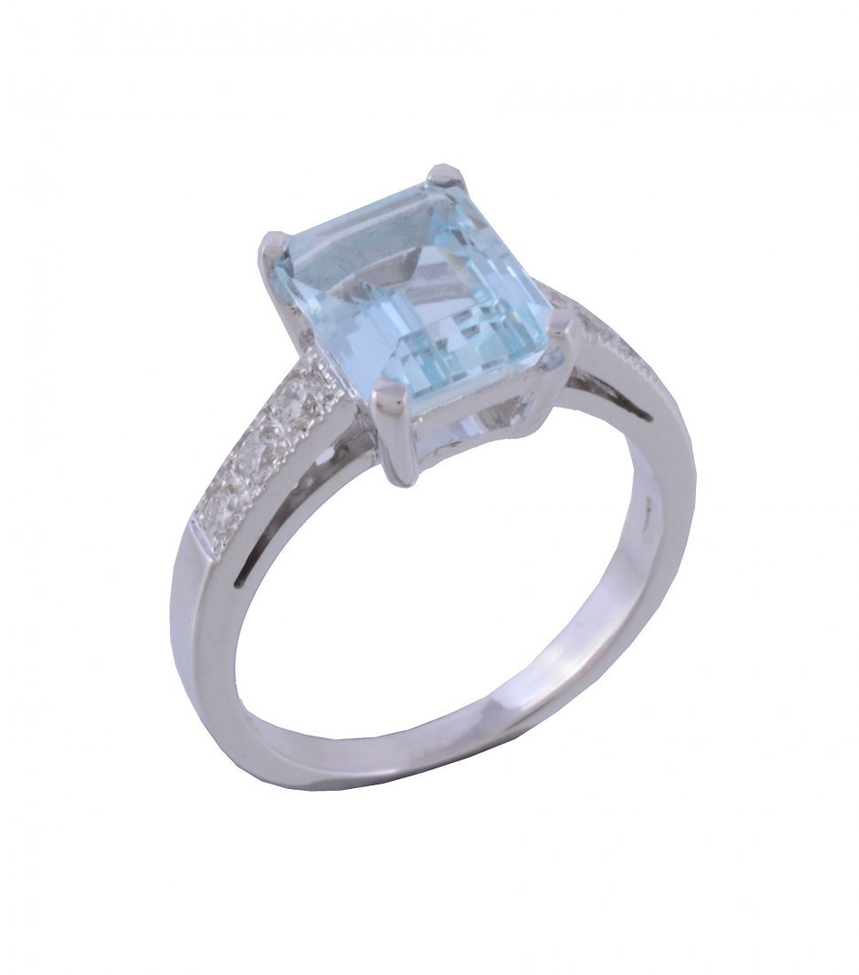 An aquamarine and diamond ring, the rectangular cut