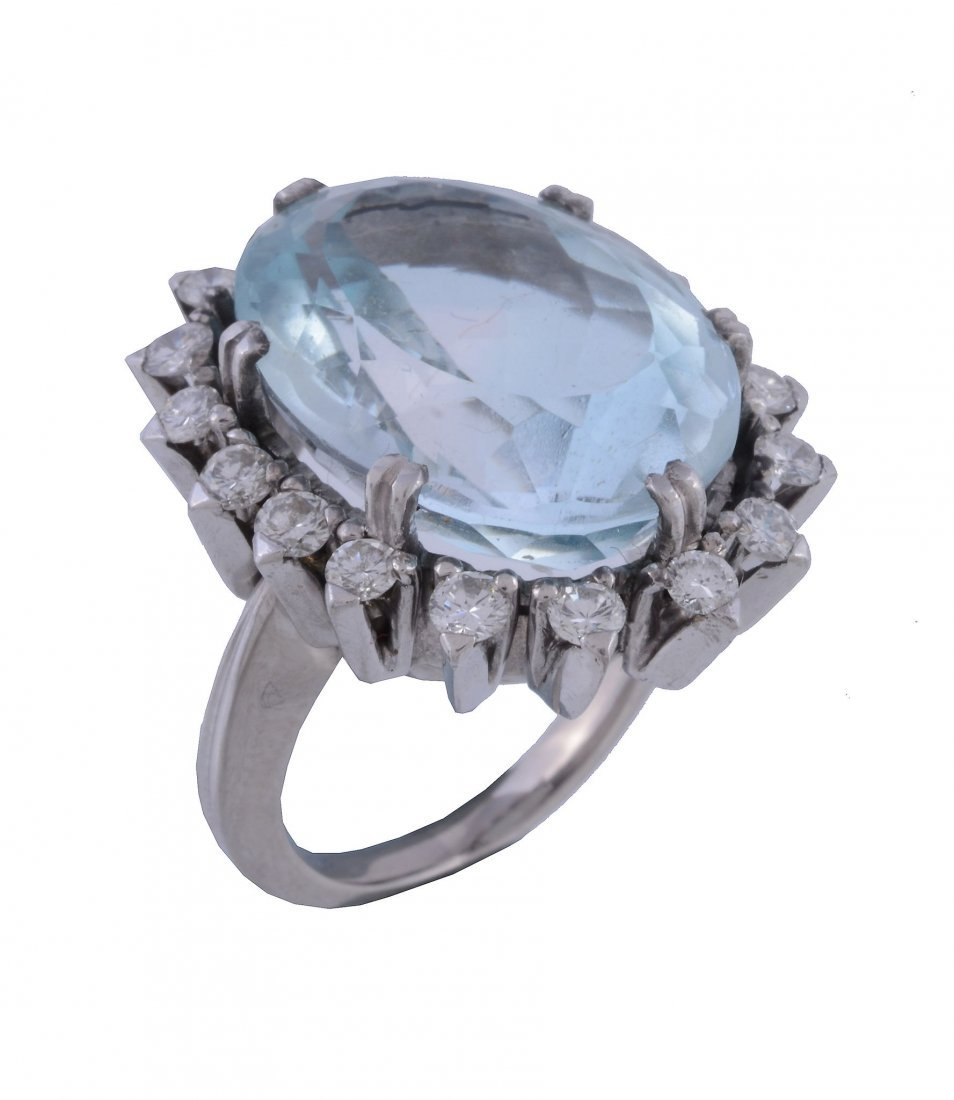 An aquamarine and diamond ring, the central oval cut