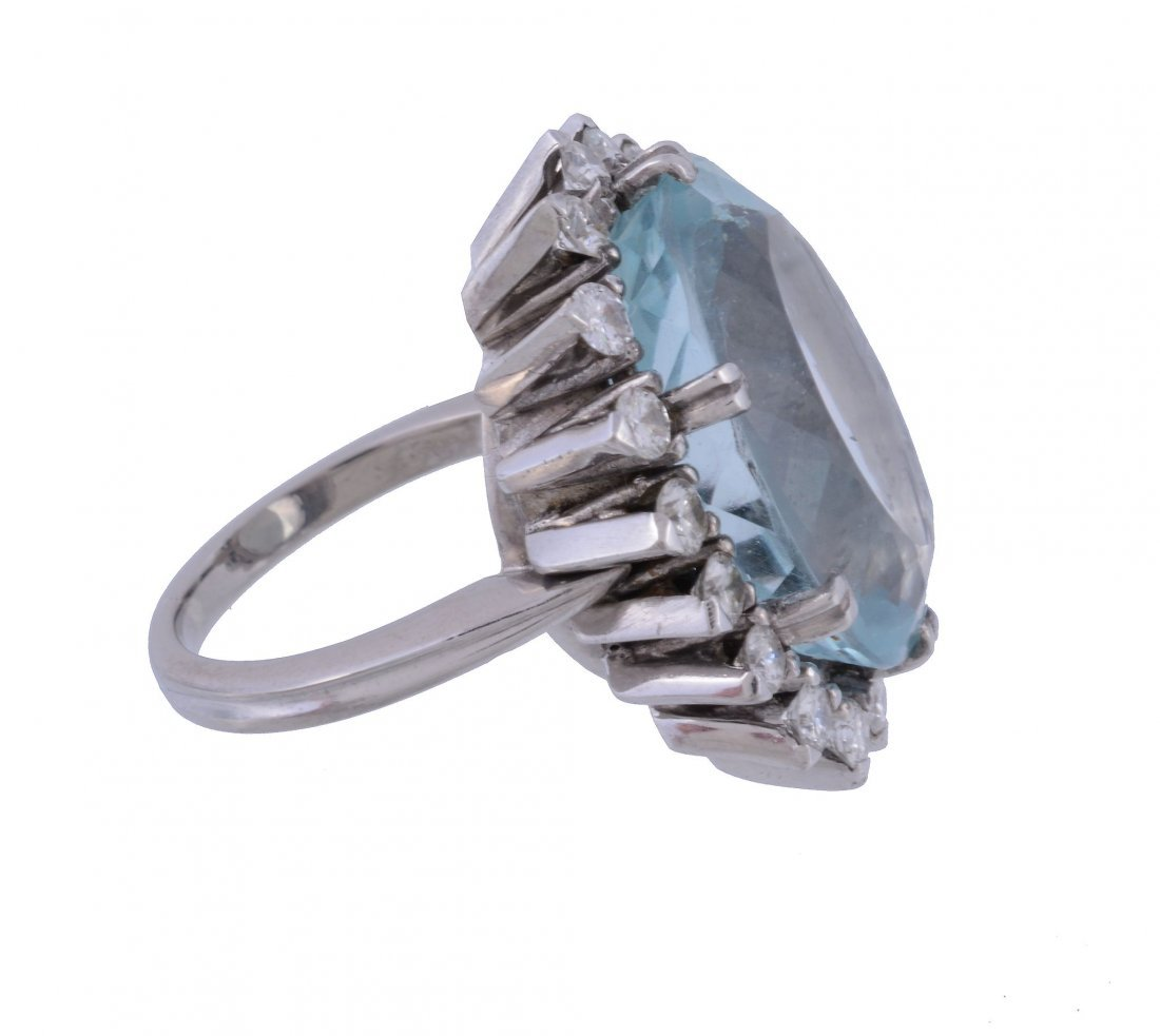 An aquamarine and diamond ring, the central oval cut - 2