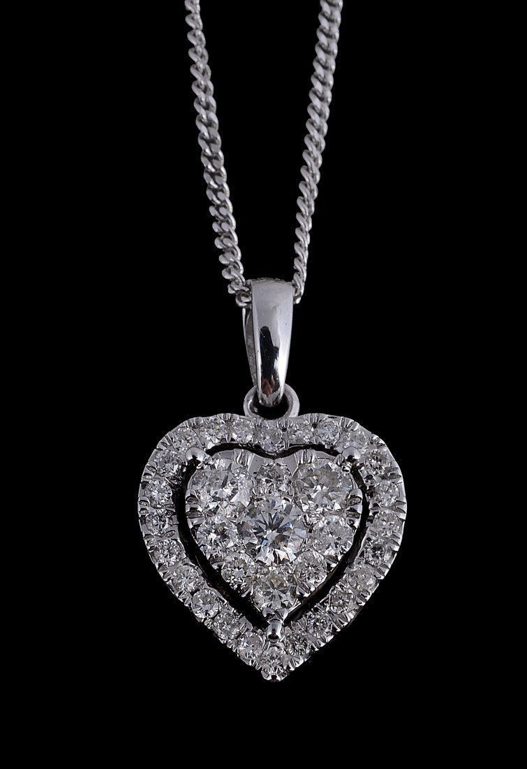 A diamond heart pendant, set throughout with brilliant