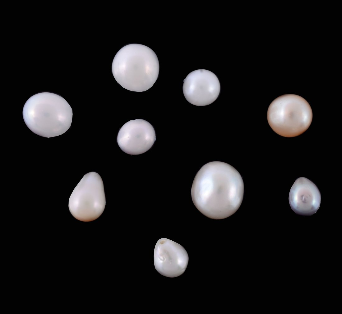 A collection of nine natural pearls , the pearls of