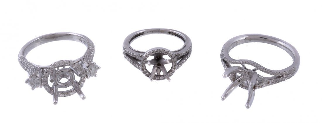 Three diamond set ring settings, each with a vacant