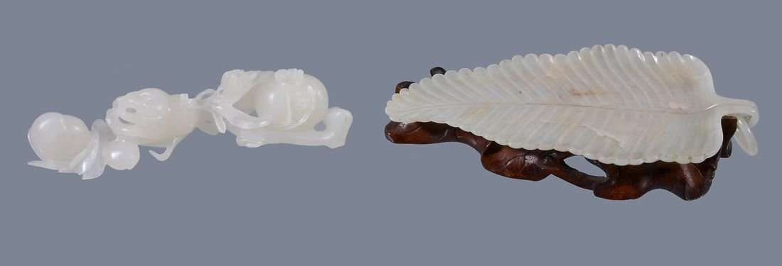 A Chinese pale celadon or white jade carving of fruit,