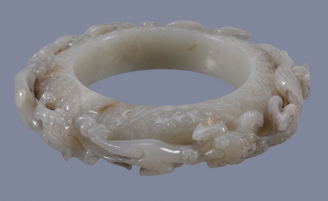 A good Chinese pale celadon 'dragon' disc, yuan - 3