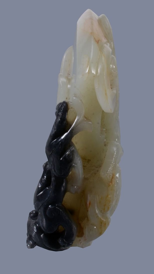 A good pale celadon and black jade 'dragon and axe' - 3