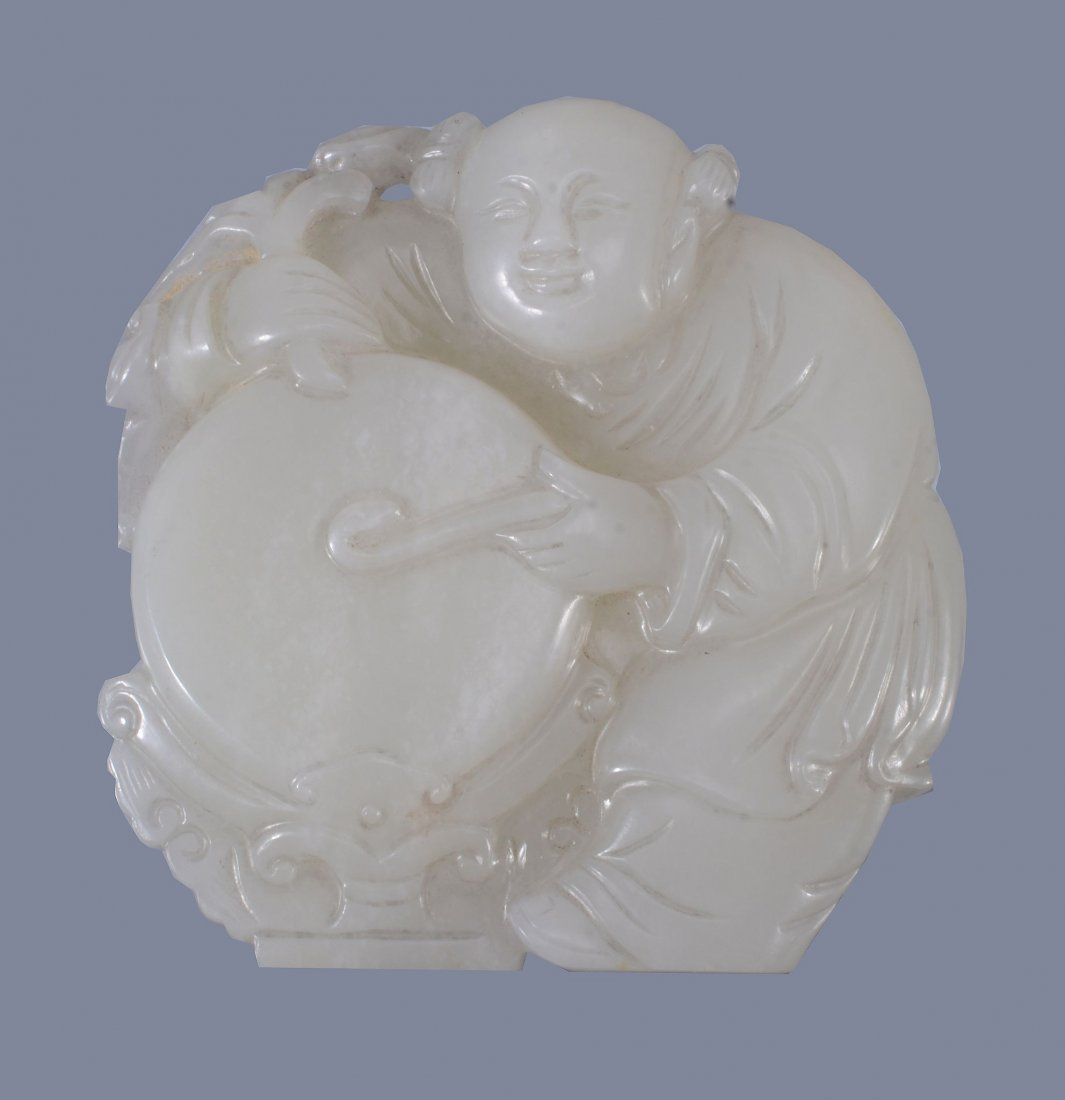 A good Chinese white jade 'Boy and Drum' pendant