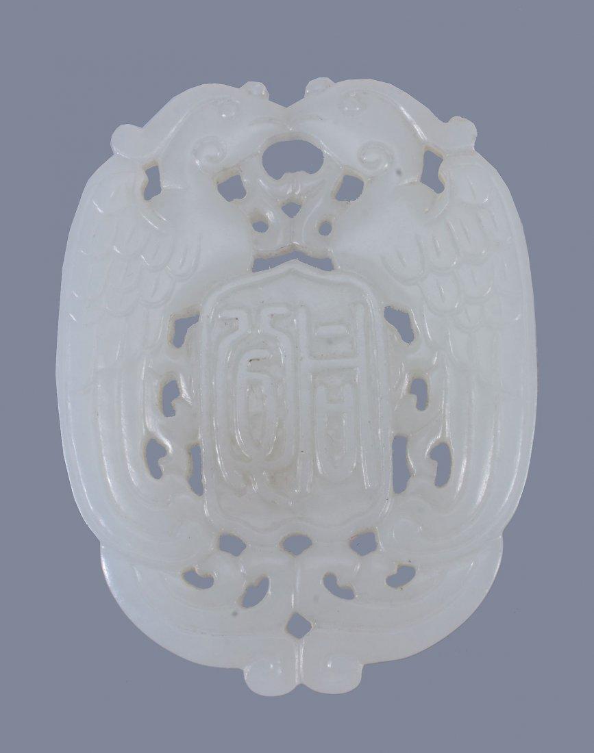 A Chinese white jade double 'Phoenix' pendant