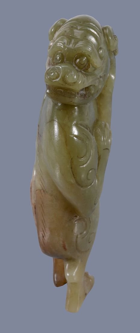 A Chinese yellow and russet jade model of a Lion, - 2