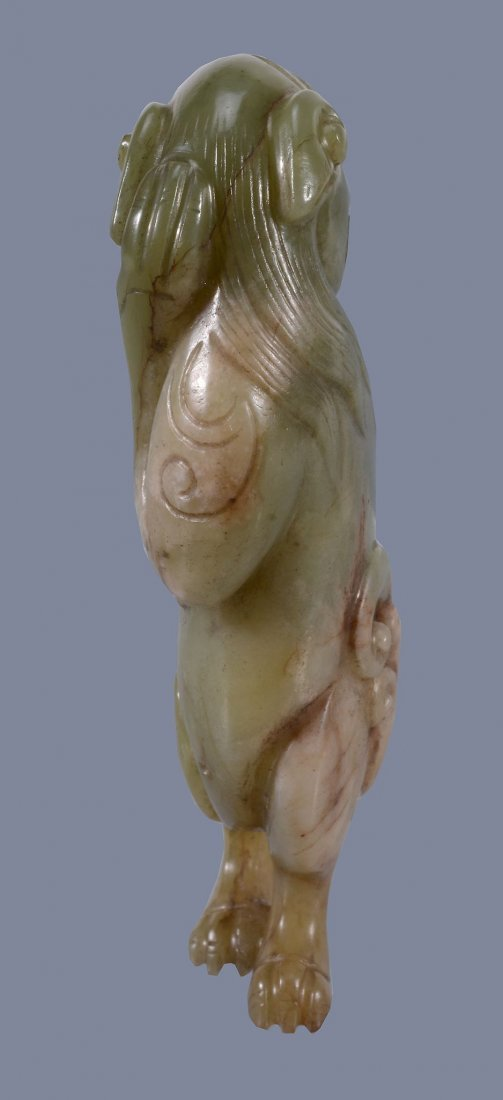 A Chinese yellow and russet jade model of a Lion, - 4