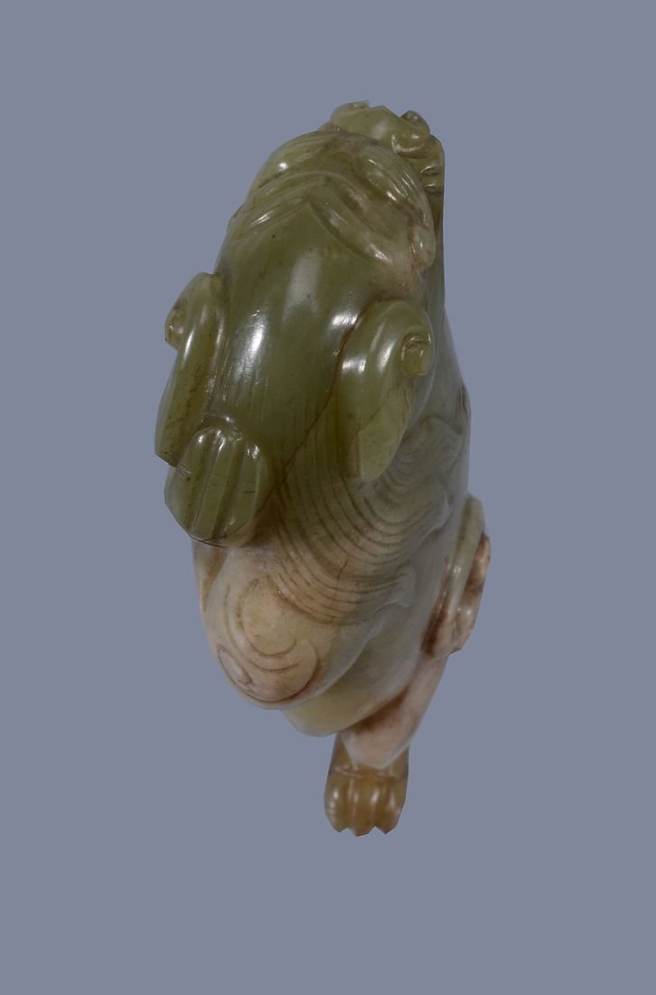 A Chinese yellow and russet jade model of a Lion, - 5