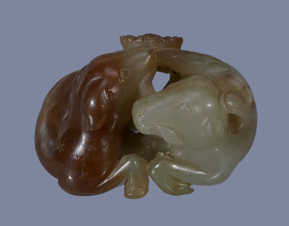 A Chinese celadon and brown jade carving of a stag and - 2