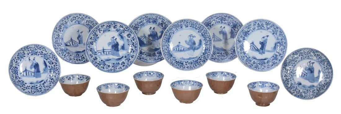 A set of six tea bowls and eight saucers, 18th century