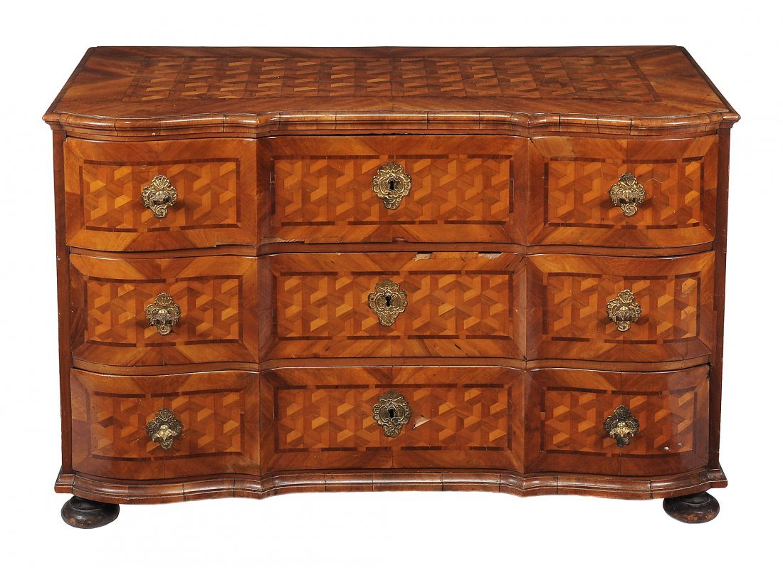 A South German walnut and parquetry inlaid chest of