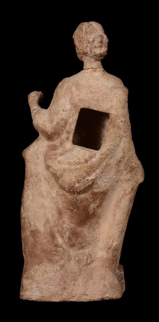 A terracotta statuette of a female enveloped in a - 2