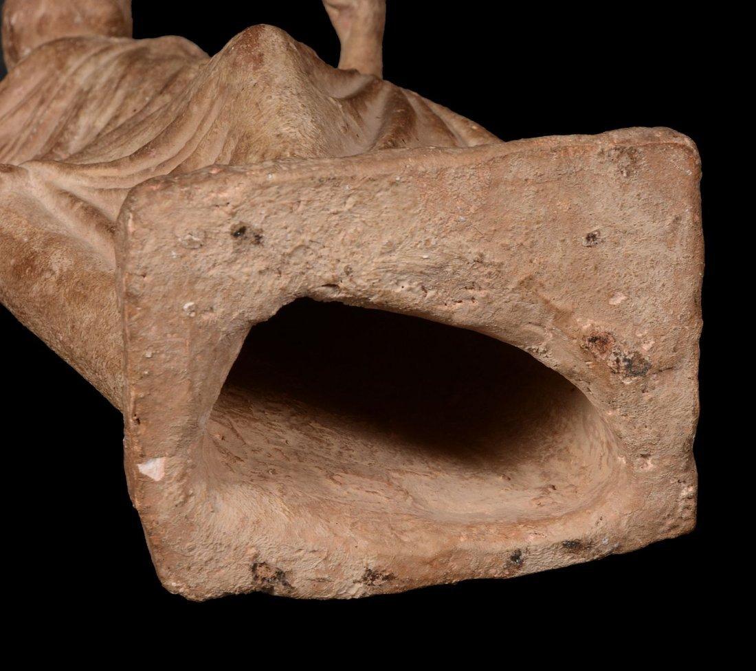 A terracotta statuette of a female enveloped in a - 3