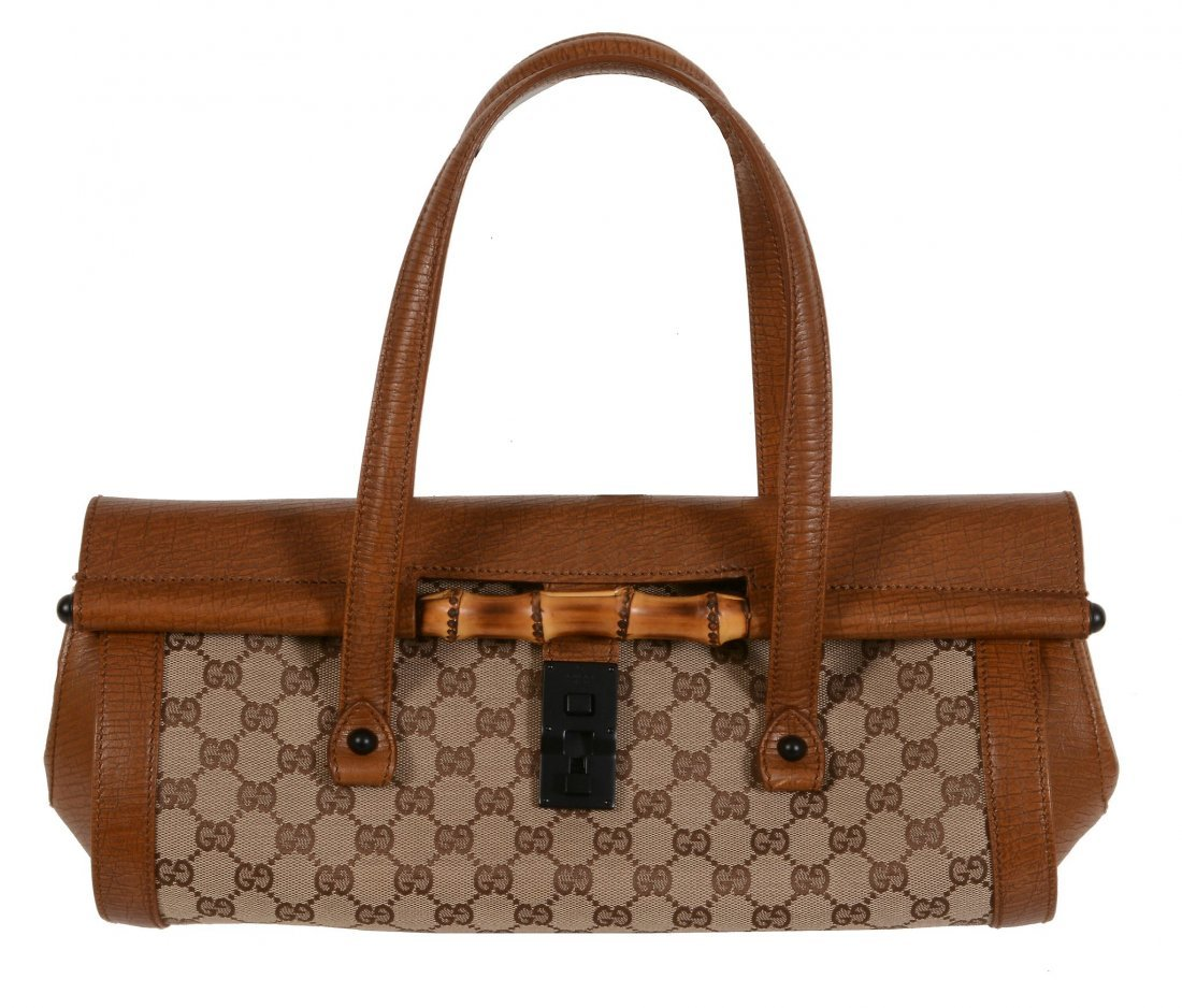 Gucci, a canvas and leather monogram hand bag, with