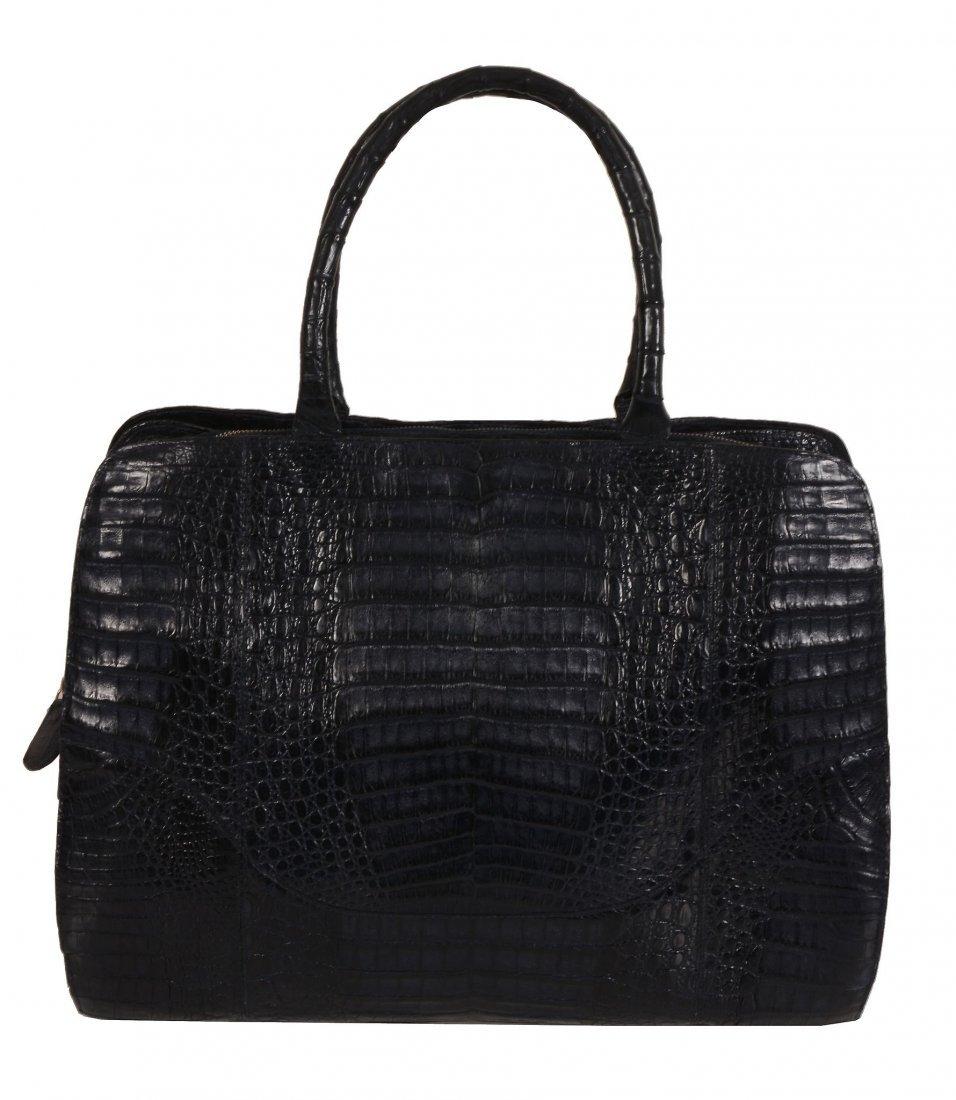 Nancy Gonzalez, a blue crocodile handbag, with twin