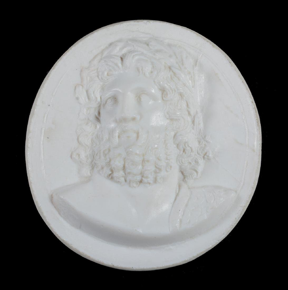 An opaque-white glass-paste round medallion of James