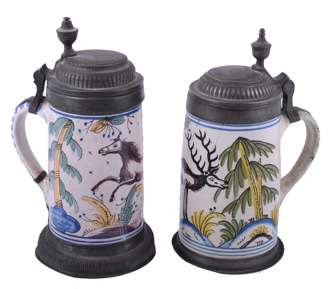 A German fayence polychrome tankard and hinged pewter