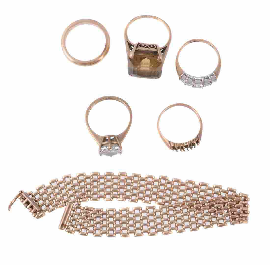 A small collection of jewellery , including a smokey