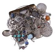 A collection of silver coloured jewellery, including