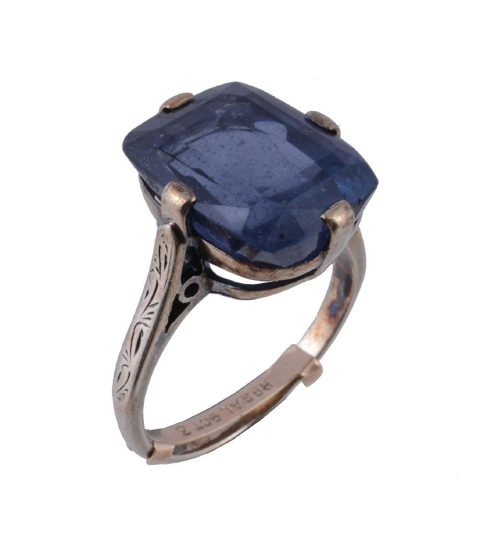 A blue spinel ring, the cushion cut blue spinel in a