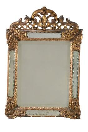 An Italian carved and giltwood marginal mirror, late