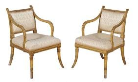 A pair of Regency carved giltwood elbow chairs, circa