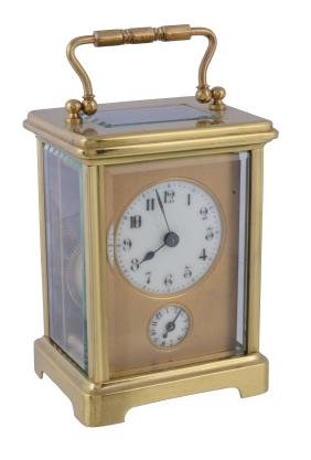 A gilt brass carriage timepiece with alarm , unsigned,