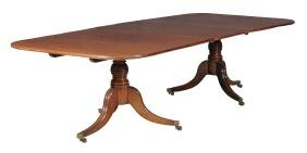 A mahogany dining table , early 19th century and later