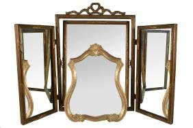An Italian carved and giltwood framed dressing table