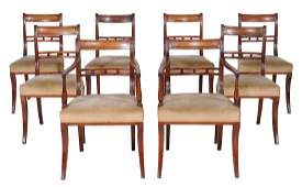 A harlequin set of eight dining chairs , seven circa