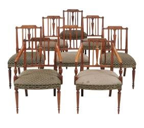 A s et of eight mahogany dining chairs, in George III