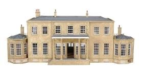 A substantial painted softwood dolls' house, 20th