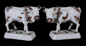 A pair of Dutch Delft models of cows, mid 18th century