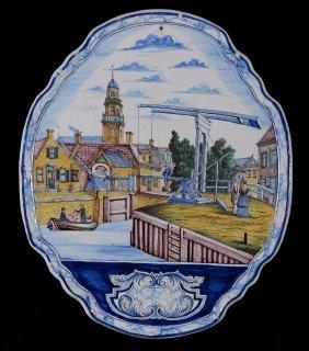 A large Dutch Delft polychrome shaped oval plaque, late