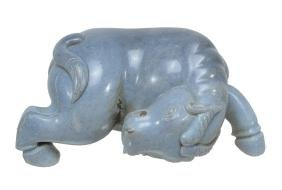 A Chinese 'blue jade' model of a horse, carved with