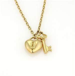 Tiffany & Co.18k Yellow Gold Puff Heart Lock & Key