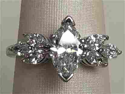 14K WHITE GOLD DIAMOND RING With three round-cut