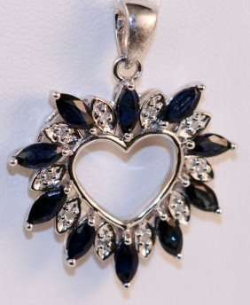 Diamond and Sapphire Heart Pendant 14k white gold.