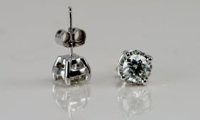 2: Diamond Stud Earrings , 14k White Gold.