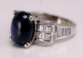 18: 14k White Gold Diamond and Sapphire Ring.