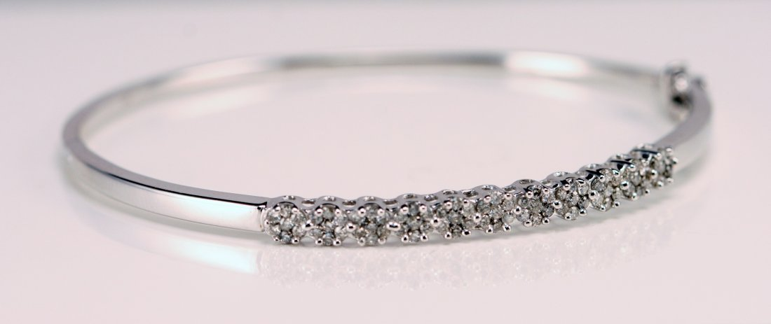19: 14k White Gold Diamond bangle Bracelet.