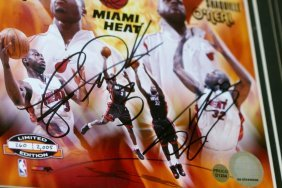 21: Wade and Shaq signed - 2006 Championship.