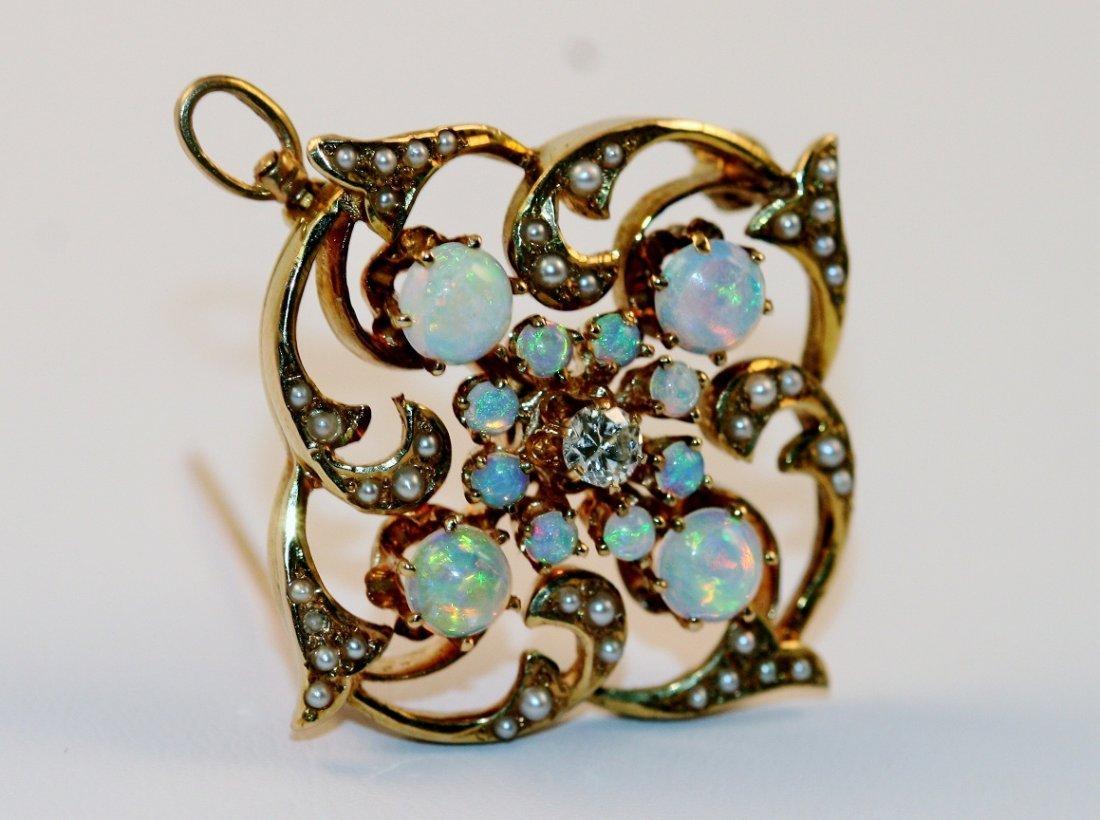 9: Old Estate diamond and opal pendant.