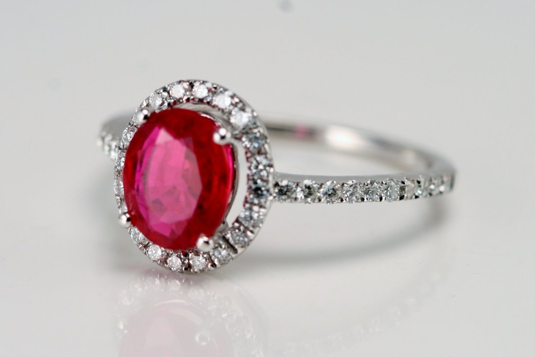 14K WT GOLD DIAMOND & RUBY RING.