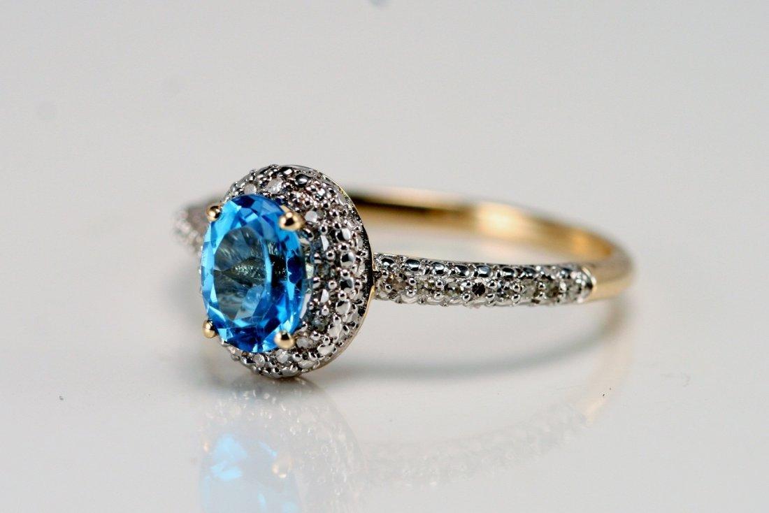 14K W/G DIAMOND & BLUE TOPAZ RING