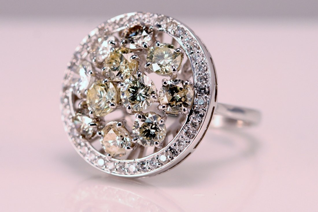 14k White Gold Ring set with White and Yellow Diamonds.