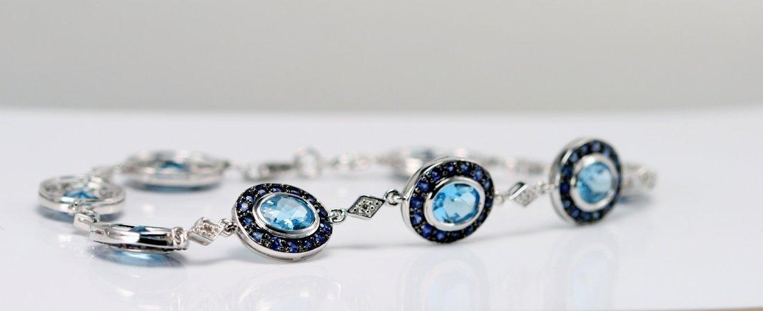 14K W/G BRACELET DIAMONDS, SAPPHIRE & BLUE TOPAZ