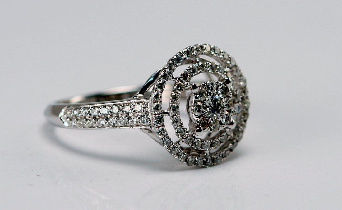 14K W/G DIAMOND RING.